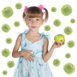 Portrait of a cute little girl in a blue dress with a fresh gree — Stock Photo