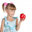 A little sweet girl with a red pepper in her hand — Stock Photo