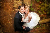 Bride and groom posing outdoors wedding day — Stock Photo