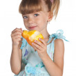 Pretty little girl with a juicy pear — Stock Photo