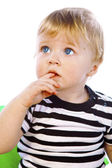 A little boy in the striped shirt sits — Stock Photo