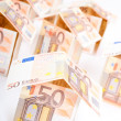 Houses from euro banknotes — Stock Photo