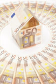 Euro house and banknotes — Stock Photo