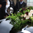 Stock Photo: Bridal bouquet on vintage wedding car