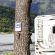 Motorhome parked alongside banning notice - Stock Photo