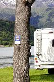 Motorhome parked alongside banning notice — Stock Photo