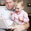 Baby pointing on laptop — Stock Photo