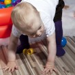 Baby taking first steps — Stock Photo