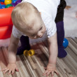 Stock Photo: Baby taking first steps