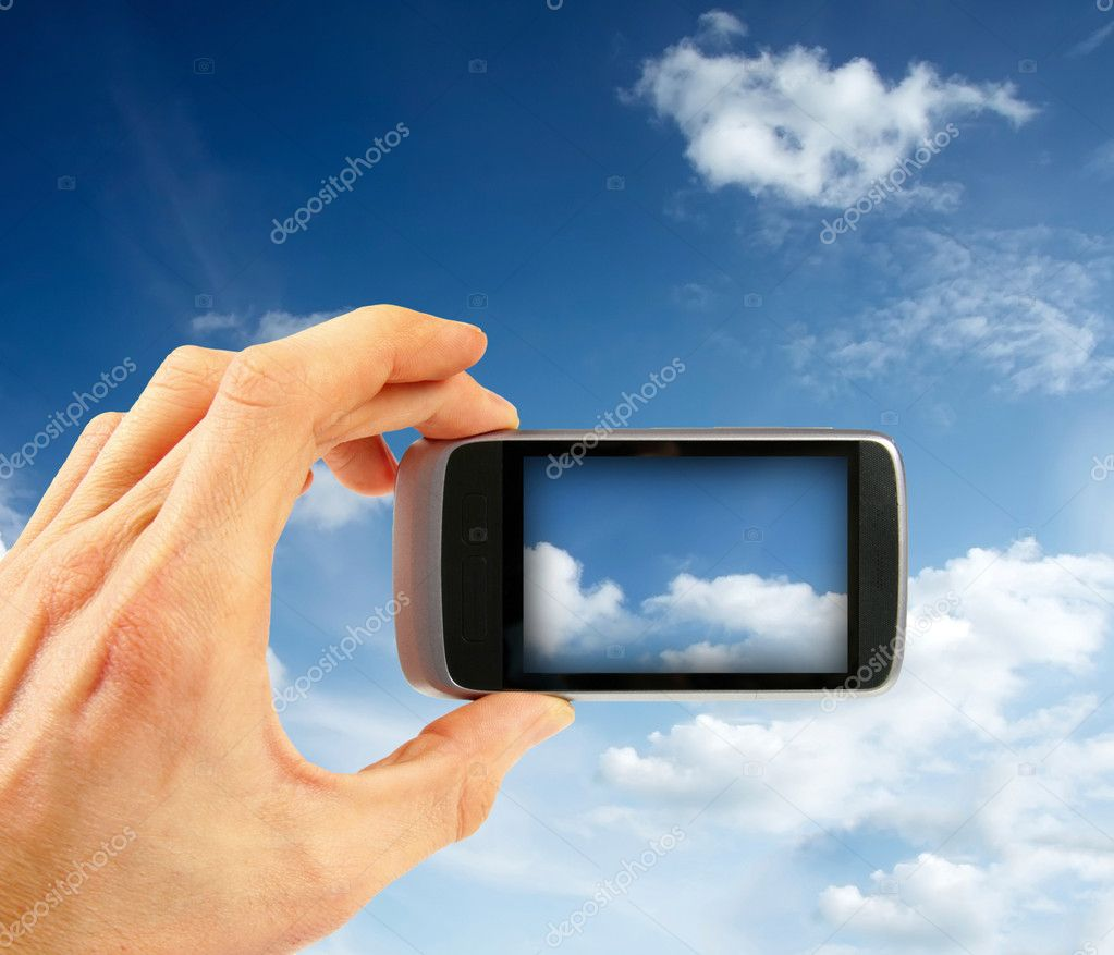 Taking sky photo with smart phone  Stock Photo #10625970