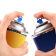 Two graffiti color spray cans in hands — Stock Photo