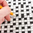 Hand doing crossword — Stock Photo