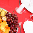 Table with plates and fruits — Stock Photo