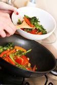 Cooking vegetables in wok pan — Stock Photo