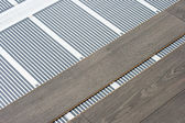 Carbon film floor heating — Stock Photo