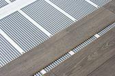 Uhlík film podlahové topení — Stock fotografie