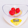 Scotch bonnet peppers on a scale — Stock Photo