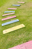 Colorful wooden path — Stock Photo