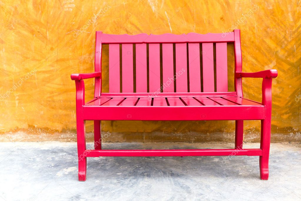Red wooden chair on vintage wall  Stock Photo #8833843