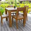 Wooden chairs and table — Stock Photo
