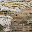 Stock Photo: Stack of old sand bags