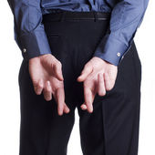 Man hold and hide on his back his cross fingers — Stock Photo