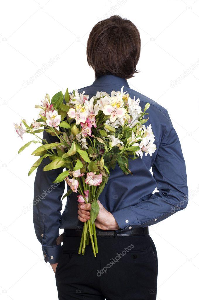 Homme tenir le bouquet de fleurs derri re son dos isol for Bouquet de fleurs homme