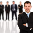 Young business man and his team. Isolated over white background — Stock Photo #9359562