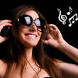 Stock Photo: Portrait of happy girl listening music in headphones. Studio sho