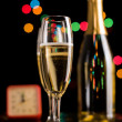 Stock Photo: Champagne glasses and bottle on bokeh background. New Year celeb