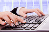 Close up of secretarys hand touching computer keys during work at the office — Stock Photo