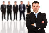 Young business man and his team. Isolated over white background — Stock Photo