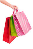 Female hand holding colorful shopping bags — Foto de Stock