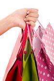 ショッピング バッグ、白で隔離されるの束を運ぶ女性手. — ストック写真