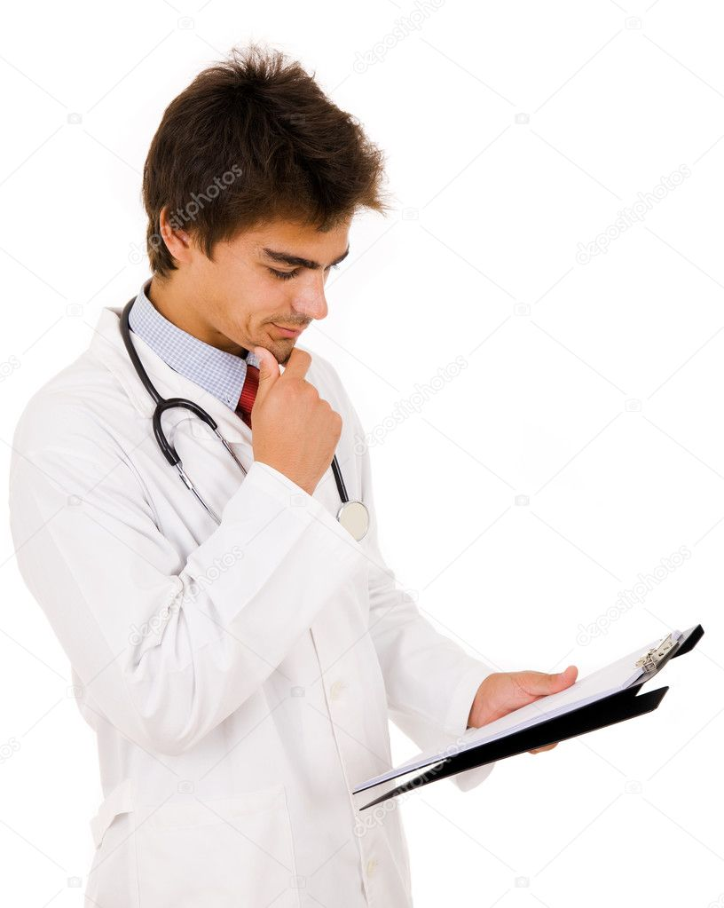 Male doctor filling out a medical document or patient examination notes  Stock Photo #9359739
