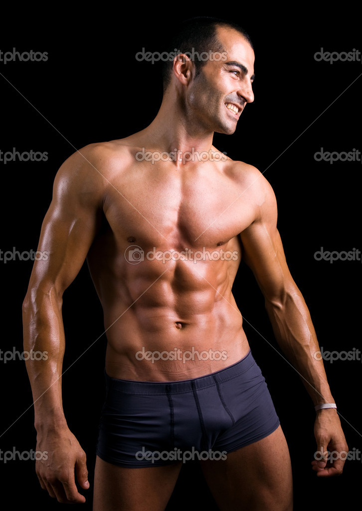 Sexy muscular man against black background — Stock Photo #9359756