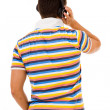 Royalty-Free Stock Photo: Back view of a young man listening music with headphones, isolat
