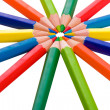 Color pencils in arrange in color wheel colors on white backgrou - Stock Photo