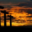 Crosses silhouette against the sky at sunset - Stock Photo