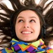 Stock Photo: Beautiful women listening music in headphones