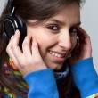 Young beautiful woman listen music with headphones - Stock Photo