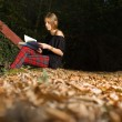 Royalty-Free Stock Photo: Young beautiful woman reading a book at autumn park