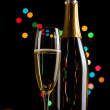 Champagne glasses and bottle on bokeh background. New Year celeb — Stock Photo