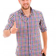 Happy casual young man showing thumb up and smiling isolated on — Stock Photo #9361611