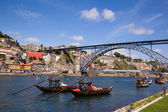 Tradicional vintage port transporting boats near famous bridge P — Stock Photo