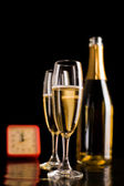 Champagne glasses and bottle on black background. New Year celeb — Stock Photo
