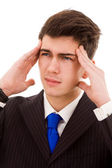 Young Business man in agony with a headache, isolated on white — Stock Photo
