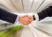Business man handshake against blur background — Stock Photo