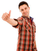 Happy young man showing thumb up and smiling. Isolated on white — Stock Photo