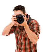 Young photographer with camera, isolated on white — Stock Photo